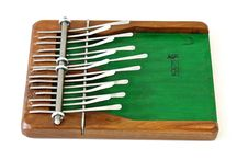 Kalimba - Thumb Piano by Roots Production - Andrew Masters / The Kalimba was adapted from the traditional Mbira of Zimbabwe and popularized throughout South-East Africa the 1960s. The angelic sound of the instrument comes from the assembly of high carbon steel notes stress mounted on a carved wooden harmonic table. we offer two sizes; the traditional Kalimba and the Mini.