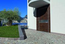 Door with Corten metal finishing / When Oikos Venezia meets cor-ten steel, it's magic