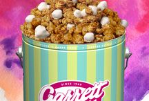 Spring has SPRUNG, and so have #GarrettSurprises! / The big ‪#‎GarrettSurprises‬ reveal is here! Our White Chocolate Covered CaramelCrisp and new Signature Spring Tin have SPRUNG up in Shops and online at www.GarrettPopcorn.com  Re-PIN if you'll be POPPING by! / by Garrett Popcorn Shops