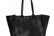 ImPRESSive Bags / by Fullah Sugah