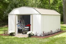 Arrow Lexington Backyard Steel Storage Shed / The Lexington Series storage shed has a barn style roof, with dual sliding doors and appealing two tone aesthetics in Eggshell & Taupe.  The Lexington Backyard Sheds come in tow sizes 10 foot by 8 foot or 10 foot by 14 foot