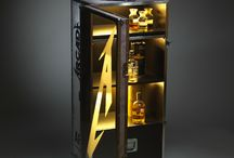 "DRINK 'EM ALL / This hardcore looking Drink Cabinet is made with authentic Adam Hall parts as featured in real life rock flight cases. All around premium quality UV decals with unique design. Inner lighting, Opti-white hardened glass doors, with huge Metallica ""A""."