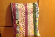A fabric bag / It is a cloth bag that has many different kinds of fabrics. I have used the front as the main page, where I've done stripes of fabric. I have sewn and applied the BP measured in order to get into this bag.