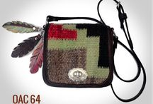 Western style handbags / Western style shoulder bag made from fine leather, vintage Navajo textile and conchos. Comes with matching hand painted leather feathers and twist closure. Made in U.S.A. For similar western style bags go to pccohandbags.com