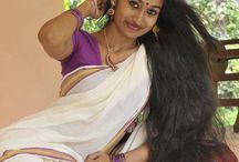 Long hair with Saree / Graceful Indian women with long hair look gorgeous in a saree, but the static charge due to internal friction of the fabric gets absorbed into the hair and causes the phlegm to move into the throat causing a quavered voice. So it is imperative to insert a heavy chabi challa(100 gms+) with a long wide hook(3.5in.L x 3/4th in.wide) at the edge of the pleats of the saree(1.5in apart and below navel hook in skin contact) which due to acupressure will keep the throat clear.