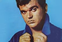* CONWAY TWITTY * / Conway Twitty September 1,1933 – June 5,1993 - Born Harold Lloyd Jenkins. Was A Country Music Artist. He Began In Rockabilly, Then To Pop Music. He Held The Record For The Most Number One Singles Of Any Act With 40 No. 1 Billboard Country Hits Until George Strait Broke The Record In 2006. From 1971-76. He Was Never A Member Of The Grand Ole Opry, But Was Inducted Into Both The Country Music And Rockabilly Halls Of Fame / by Lena Hostetter