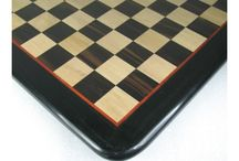 WOODEN CHESS BOARDS - chessbazaar.com / We have a excellent range of chess boards in ebony, shesham, rose wood and bud rose wood. Our chess boards are inlaid wooden boards which gives them longer life.We do not use veneer or solid wood to make our boards as these kind of boards have problem of warping and cracking in the long run. The wooden boards that we have are hand sanded and then lacquer polished to give a b'ful long lasting shine.