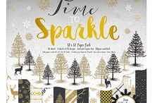 Dovecraft Time to Sparkle / Welcome in the festive season with Dovecraft's luxurious Papercraft collection, 'Time to Sparkle'. Contemporary and enchanting, the majestic black and gold papers designed by Katie Pertiet feature illustrations of reindeer, snowflakes, and elegant stripes and polka dot patterns. To add to the stylish collection of papers, the pads also feature a scintillating foil and glitter effect to make each Christmas craft twinkle!