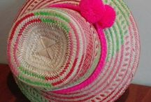 Wayuu Hats Pompons /  Wayuu Hats with Pompons,handmade by Wayuu Indigenous. One of a Kind. Different Hat Bands with Pompons designs  www.thesuncollection.com info@thesuncollection.com +57-318-589-5810