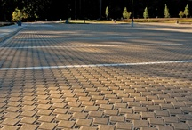 Parking Lots Go Green with Concrete Pavers / Permeable pavers reduces stormwater runoff from expansive impervious surfaces. This pavement can also reduce or eliminate detention ponds and drainage infrastructure thereby reducing overall project costs. As a new or retrofit pavement, reduced runoff from permeable pavement further reduces flooding from storm sewers operating at capacity as well as pollution from combined sewer overflows. For these reasons, permeable pavers are seeing increased use in streets, alley and parking lot projects.