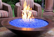 Natural Gas Fire Pits / What exactly draws us to a fire? We're not sure, but these fire pits are extraordinary. Natural gas makes them simple to use. Flipping a switch or using a remote keeps them extra easy to enjoy.