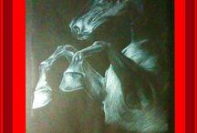 Dibujo sobre papel oscuro. / Lápiz blanco sobre negro.