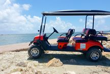 Our Golf Carts / Our brand new 4 and 6 seat golf carts have extended roofs and windshields.