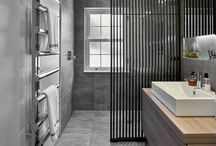 Stylish Contemporary Shower Room - Silver tiles, Rimadesio space divider and floating furniture / hobsons|choice designed and installed a stunning silver tiled shower room featuring a Rimadesio space divider and 'floating' Alape furniture.