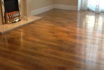 High Gloss Laminate Floor / installation of High Gloss Walnut effect laminate flooring and marble fireplace. http://www.ppmsltd.co.uk