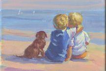 2 jongetjes met hond op strand