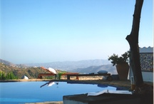 By the pool at El Carligto / I feel on top of the world with the mountain, La Maroma, to my side as the valley falls away to the sea beyond the pool.