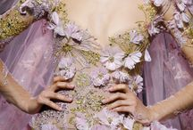 Winter Bride / An ethereal glow illuminates the Haute Couture Autumn Winter 2016-17 runway: The winter bride, a captivating vision of blossoming flowers in feathers adorned with golden silk threads. Source of inspiration and admiration, the ELIE SAAB Haute Couture bride is out of a fairy tale. Indulge in the opulence and the details of the #ImpressionsOfNY Winter Bride.