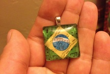 Glass Tile Pendants / Look what you can do with a simple glass tile! Find supplies to finish your idea here: http://www.ecrafty.com/c-6-photo-jewelry.aspx