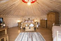 Luxury Glamping / A stay in a Yurt is far from your average holiday, where else can you feel so close to nature and be tucked up in a warm, comfortable bed by the end of the day! Each Yurt has been lovingly furnished with beautiful rustic wooden furniture and the grounds around the yurts has some fantastic facilities to enjoy including an outdoor heated pool and children's play area.