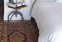 Rugs in Your Bedroom / Rugs serve a practical purpose in the bedroom. Not only do they create a warmer atmosphere, they also help reduce noise, keeping your bedroom quieter.