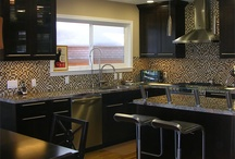 Kitchen Space / Cook up in style with spacious islands, tiled back-splash, stainless steel appliances and pops of color!