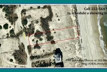 Great Oceanfront Outer Banks NC Lot for Sale | 2309 Sandfiddler Rd / Escape the Pavement and check out the views from this Oceanfront Lot in Carova Beach. this lot offers a high dune and good terrain for your future beach house. As a bonus, there is a 10 foot pedestrian easement to the North. Enjoy watching the dolphins swimming in the ocean The Pelicans flying overhead, and the Corolla Wild Horses walking through the sand. Buy this lot for sale now by calling me, Jean-Paul Peron, at 252-564-9390.