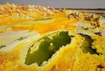 Dankile Depression / The Danakil Depression, also called Dallol Depression, is a desert with some areas that are more than 100 meters below sea level. This is special because it is one of the lowest points on earth not covered by water. There are hot yellow sulfur fields among the sparkling white salt beds. Heat isn't the only thing people feel in the Dallol Depression. Alarming earth tremors are frequently felt. There are also several active volcanoes such as Earta Ale.