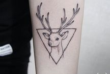 Tattoo Deer - a symbol of the Sun.