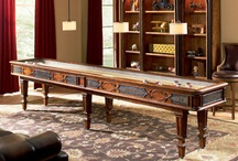 Spring 2012 High Point Mkt - Game Room Collection / Ambella Home will unveil the newest additions to its growing game room collection during the Spring 2012 High Point Market in IHFC Showroom  C-357. From new styles for its popular shuffleboard table to pool and foosball tables to dartboard and spectator chair designs, the latest introductions offer versatile, upscale looks for any game room décor.