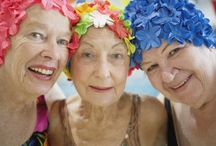 older woman in swimsuits and bathing caps