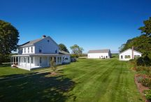 6175 Oregon Road, Cutchogue NY / A once in a lifetime opportunity to own nearly 50 acres of soundfront property has become available for the discerning purchaser. Set on one of the area's premier roads, in the heart of North Fork wine country, this unique compound includes a restored farmhouse, working vineyards, manicured farmlands, beautiful waterfront buildable lots and much more.
