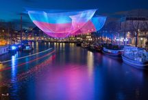 Light Festivals around the globe / Winter is the time of light. As longer and darker nights set in, light art festivals brighten up cities and towns across the globe. We embark on a journey to investigate the stories behind the colorful installations – come with us and off we glow.