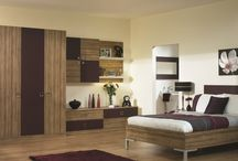 Bedroom Styles from Universal Interiors / From delicate shades and wood tones to pools of glossy colour, we are confident that you will find a bedroom range that you will love. No matter which you choose, we will be able to provide a made to measure service which will provide a perfect fit, even in rooms with awkward corners or sloping ceilings.