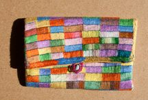 Purses & Bags - Hand Embroidered in Madagscar / A range of hand made multicoloured purses and bags, all made by women in a tiny village in Madagascar. STITCH Sainte Luce is a sustainable livelihoods programme training women embroiderers in south east Madagascar.