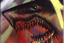 """SHARK TOOF by WIDEWALLS / Shark Toof is a Los Angeles based artist. Shark Toof graduated from Pasadena Art Center College of Design with a BFA in Illustration in 1998. SHARK TOOF takes an in-depth look at the ambitious and versatile street artist. Shark Toof, best known for his emblematic visual calling card: a wheat pasted, hand drawn shark head, which the artist describes as the """"perfect culmination of all my angst, protest, strength and optimism."""""""