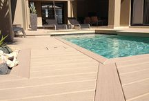 Poolside decks / Pool and hot tub surrounds built with moisture-resistant MoistureShield composite decking.