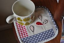 Stitches:Mug Rugs/Coasters/Placemats / Placemats and mug rugs could be designed to match or coordinate, along with the coaster.   I love to see what people come up with.