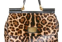 Leopard is a must! / by Jamie Mcgauhey