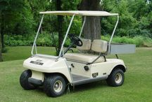 Golf Carts / A golf cart is a small vehicle designed originally to carry two golfers and their golf clubs around a golf course or on desert trails with less effort than walking