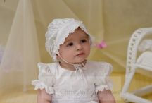 Girls Silk Christening Gown with Tulle Skirt / Beautiful silk christening gown for girls with matching bonnet. Pearl button and tie closure. http://www.christeningapparel.com/christening-gowns/baptism-dresses/meghan-silk-christening-gowns.html