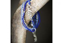 Sieraden / Sieraad armband Ster gemaakt door de Artisan Smederij en de vrouwengroep Beads for Life in Nepal.