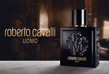 Roberto Cavalli Uomo / Roberto Cavalli Uomo's perfume is a striking manifesto of style and intent. Combining Cavalli's sense of theatricality and glamour with a rock and roll edge, the flask is made of heavy dark glass, embossed with the fashion house's famous monogram.