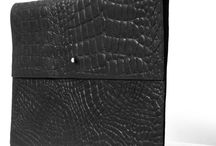 Leather laptop sleeves / This must have sleeve protects your laptop from scratching with its soft interior.