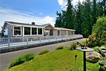 Home For Sale in Oak Harbor / Equestrian view property on 11+ acres. Features 30,000 Sq Ft steel frame indoor horse arena 100X300 with viewing deck. River rock bottom footing material, halogen lights/skylights, wash rack, washer/dryer, treadmill, with 16 stalls and 4 tack rooms. House is over 2,700 sq ft home in immaculate condition with Huge Chef's kitchen/ island, stainless appl, vaulted ceilings and double sided fireplace. Office, Large Mstr bed with private bath and solarium. 3 decks with views of Bay/Mt Baker.