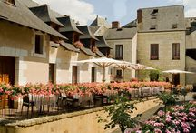 Hotel Hostellerie La Croix Blanche / Historic country house hotel in the Loire Valley, France. Logis hotel with restaurant, bar-lounge, pool, flowered terrace.