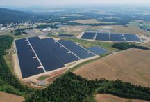 Renewable Electricity. Solar Panels and Wind Turbines powering Electric Heaters / Electric heaters can be powered by green electricity from solar/wind/fuel cells/nuclear, etc.