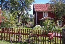 Lantligt Stuga och Trädgård