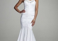 Bridal Wedding Dresses / Short, long or just classic you want to pick the right affordable bridal wedding dresses for everyone involved. / by Wedding Guide