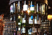 Lighting Wine Bottle / These hand forged iron wine bottle chandeliers are perfect for accenting your wine cellar lighting or for an accent to any restaurant concept lighting location. Fill with your favorite wine labels. Also available with custom colored hand blown wine bottles that light up in many gorgeous colors. You won't fond a more quality wine bottle chandelier anywhere!